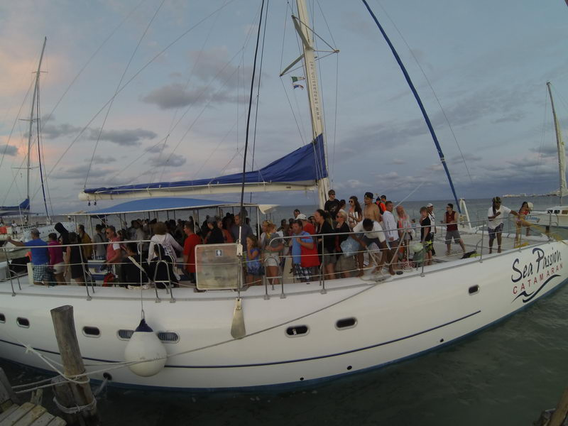catamaran with people aboard